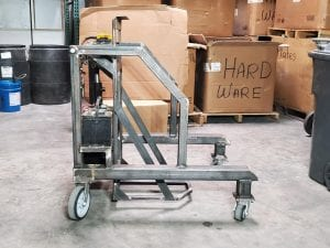 Side view of a cart tipper in a warehouse