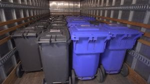 Photo of carts lined up in the back of a truck neatly